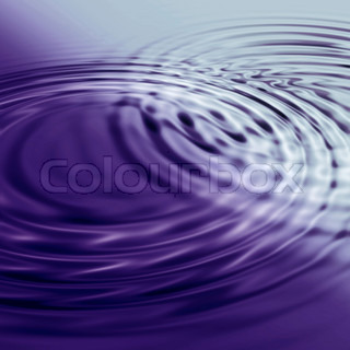 Deep blue water background with circular ripples from the rain