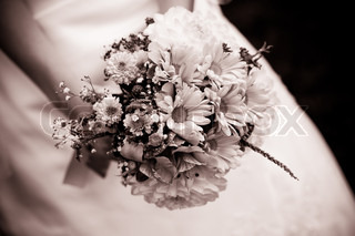 The bride with a wedding bouquet close up outdoor Shallow deep of field, chocolate tonning