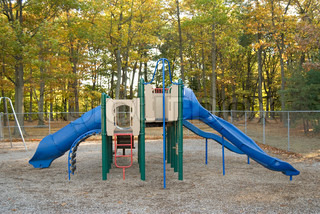 A brightly colored play scape at the park A fun place to be when you're a kid!