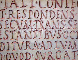 Pre-christian latin writing carved on the tombstone