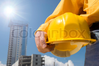 focus point on the hard-hat and hand, special toned and sun light photo f/x