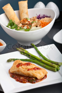 Freshly prepared Thai style sea bass fish dinner with asparagus and appetizer with a contemporary presentation