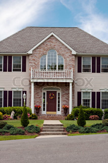 A large custom built luxury home in a residential neighborhoodThis high end house is very nicely landscaped property