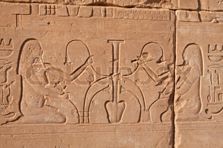 Egyptian stone carving on the walls of Karnak temple