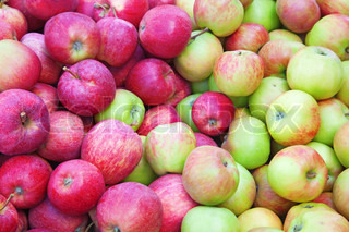 Red, green and yellow ripe apple background