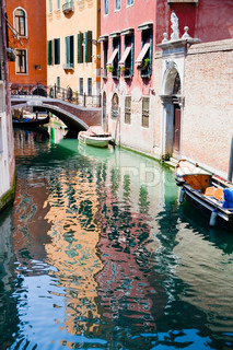 canal, boats and bridge in Venice, Italy