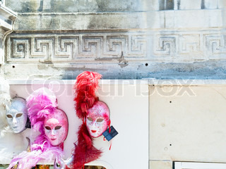venetian carnival masks on old wall in Venice, Italy