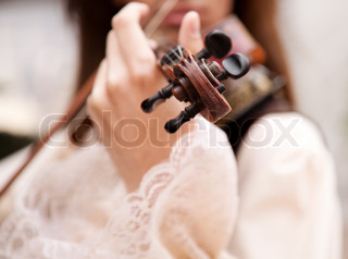 man with vintage violin , selective focus on nearest part