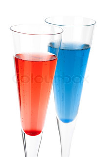 Red and Blue Champagne alcohol cocktail isolated on white background Ingredients: 1 oz grenadine (or blue curacao) and 10 oz champagne