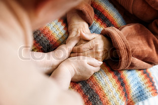 adult helps senior in hospital,selective focus