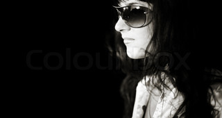 woman with big sunglasses with street reflection,black and white toned photo f/x