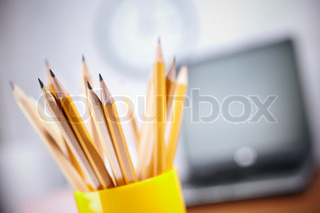 office concept with different pencils in close up, selective focus on nearest, shallow depth of field