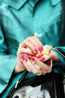 Hands of a woman full of rose petals ready to throw