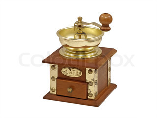 Wooden manual coffee grinder isolated on a white background