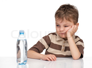 Portrait of a cute boy with a bottle of refreshing water - isolated on white