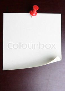 Single blank note paper attached to a black wooden wall