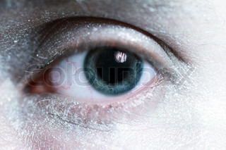 beautiful blue male eye with silver makeup around the close