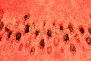 watermelon red pulp with seeds macro background