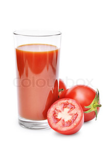 Drinking glass with tomato juice and ripe fresh tomato near isolated on the white background