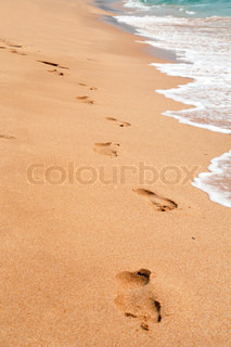 footprint on the sea sand beach summer vacation background