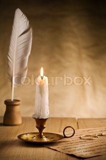 burning candle in vintage candlestick