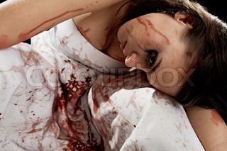 brunette in blood isolated on black background
