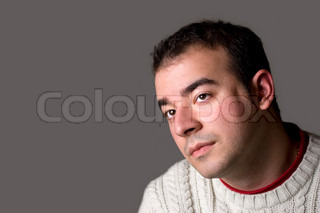 A young man thinking about something isolated over a silver background