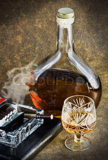 bottle of brandy and smoking a cigarette