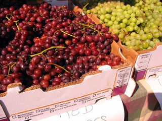 Some red and green grapes for sale at the farmers market