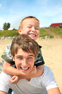 happy teenager and kid portrait outdoor