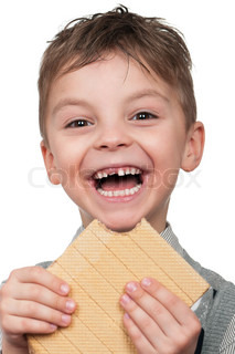 Portrait of a cute boy having a waffle - isolated on white