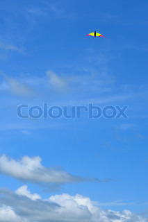 flying kite over blue sky and clouds background