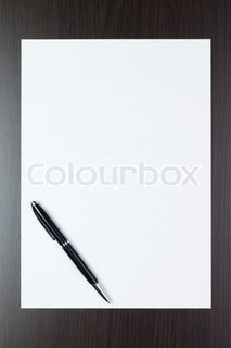 blank sheet of paper on the table with a pen