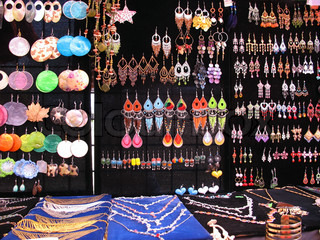 A very colorful assortment of jewelry on displayMany of these are isolated nicely over black, and can be cut out very easily