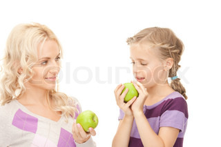 picture of mother and little girl with green apple