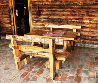 rustic wooden benches and table in rural Serbia