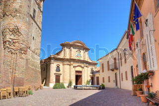 Central plaza with small church among city hall and ancient castle in Roddi - small town in Piedmont, northern Italy