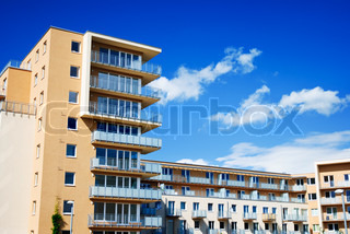 New modern apartments in front of blue sky