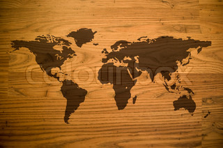 A map of the world and all of the continents over a woodgrain texture