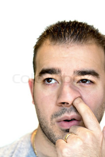 A shot of a man digging for gold - the nose picker