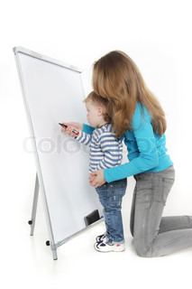 brother and sister writing on white board