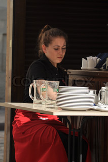 A girl-waiter in cafe