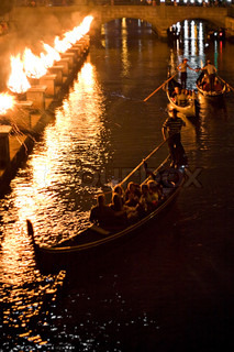 Gondolas on the canal at night during a Providence Rhode Island WaterFire event