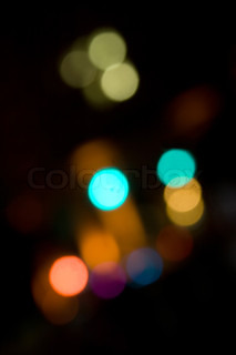 An abstract bokeh background with blurred light blobs