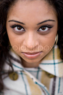 A closeup of a pretty Indian woman from a high angleShallow depth of field with strong focus on the eyes