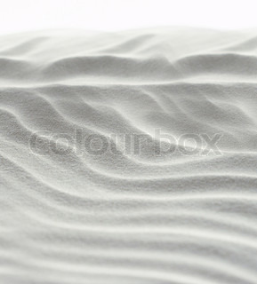 Abstract background of white sand ripples at the beach