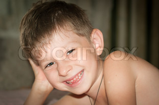 Portrait of the nice smiling boy of five years