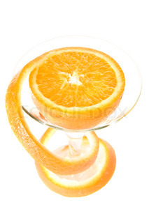 Orange with long a peel in a glass, a zest bend a spiral, on a white background