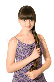 The beautiful young girl teen with long hair on a white background isolated