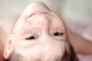 Smiling, cute five year old boy portrait on background